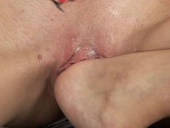 Alluring loveliness is pounding her sexy twat with hard sex-toy